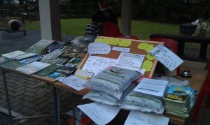 A board to share more about the edible garden. Compost courtesy of Green Back. Books, etc courtesy of Nature Society.